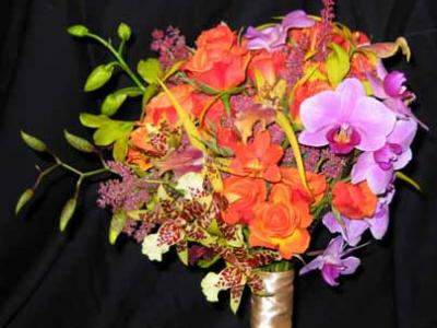Orchid bridal bouquet with seasonal cut flowers
